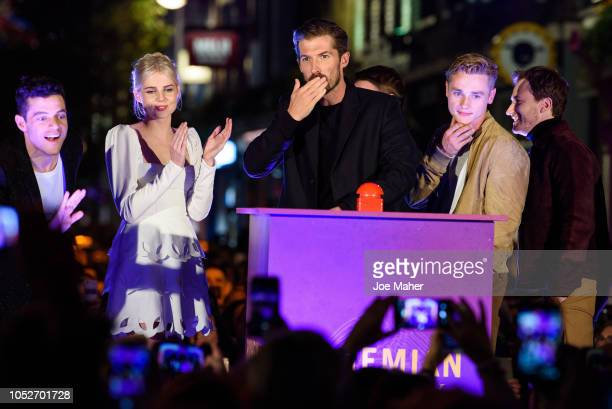 Rami Malek Lucy Boynton Gwilym Lee Ben Hardy Joe Mazzello Brian May and Roger Taylor during the Bohemian Rhapsody light switch on ceremony at Carnaby...