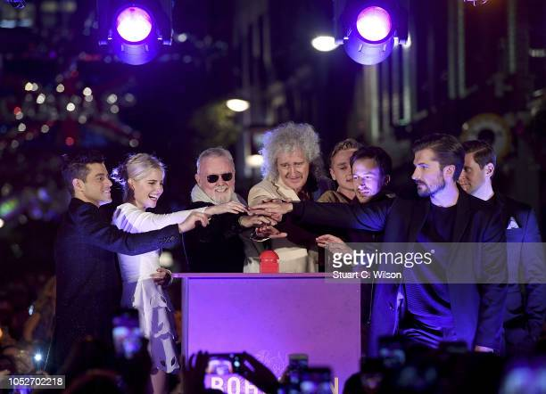 Rami Malek Lucy Boynton Roger Taylor Brian May Ben Hardy Joe Mazzello and Gwilym Lee turn on the Carnaby Street Bohemian Rhapsody Light Installation...