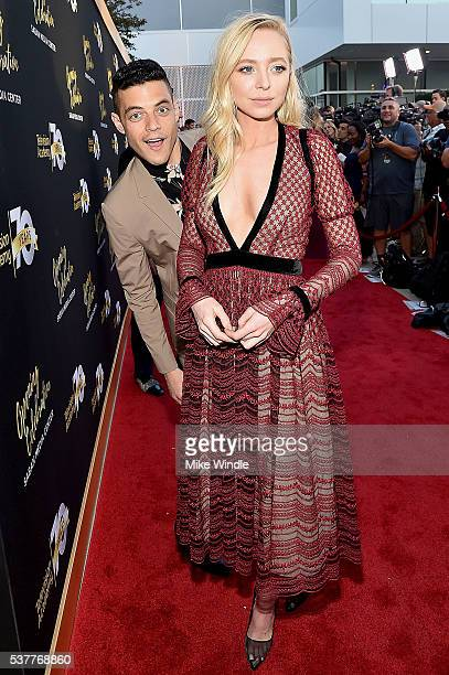 Rami Malek photobombs Portia Doubleday during the Television Academy's 70th Anniversary Gala on June 2, 2016 in Los Angeles, California.
