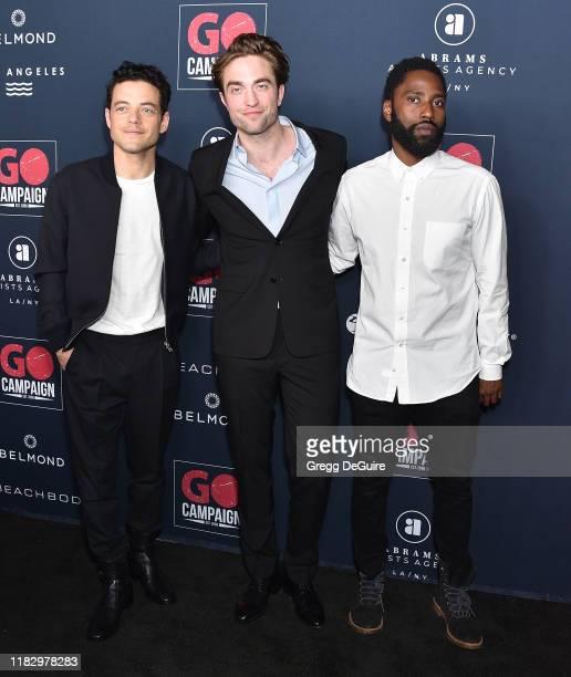 Rami Malek Robert Pattinson and John David Washington arrive at the Go Campaign's 13th Annual Go Gala at NeueHouse Hollywood on November 16 2019 in...