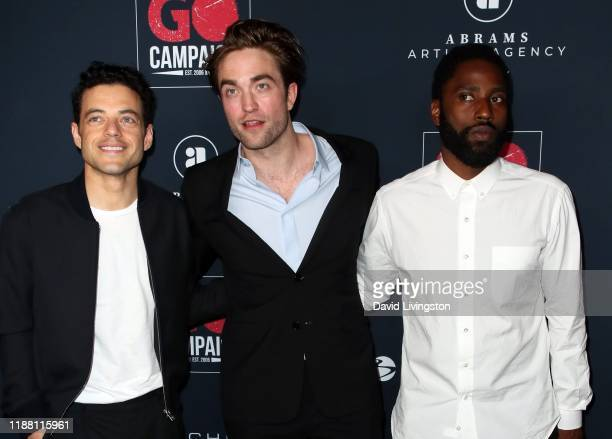 Rami Malek Robert Pattinson and John David Washington attend the Go Campaign's 13th Annual Go Gala at NeueHouse Hollywood on November 16 2019 in Los...