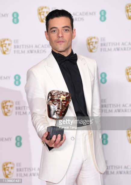 Rami Malek, winner of Best Actor for the film Bohemian Rhapsody poses with his award in the press room during the EE British Academy Film Awards at...