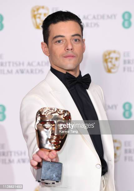 Rami Malek winner of Best Actor for the film Bohemian Rhapsody poses with his award in the press room during the EE British Academy Film Awards at...