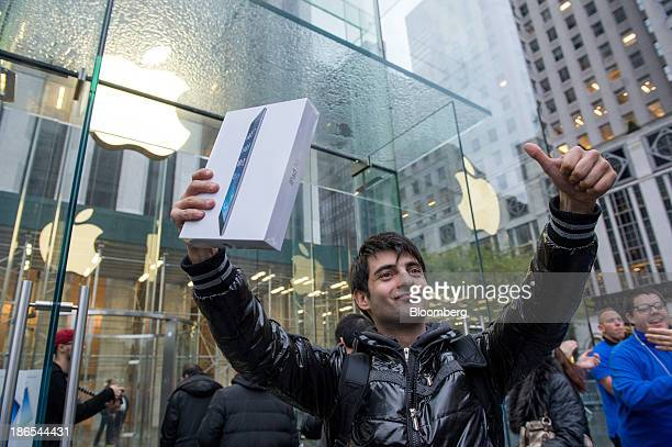 Rami Shamis celebrates after being the first to buy the new Apple Inc iPad Air at the 5th Avenue Apple store in New York US on Friday Nov 1 2013...