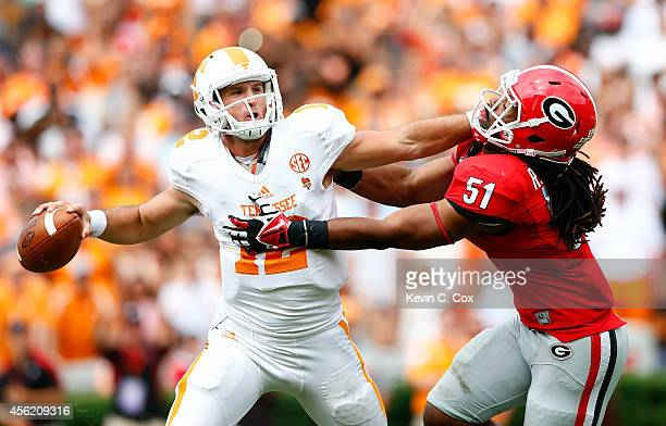 Ramik Wilson of the Georgia Bulldogs pressures Nathan Peterman of the Tennessee Volunteers at Sanford Stadium on September 27, 2014 in Athens,...
