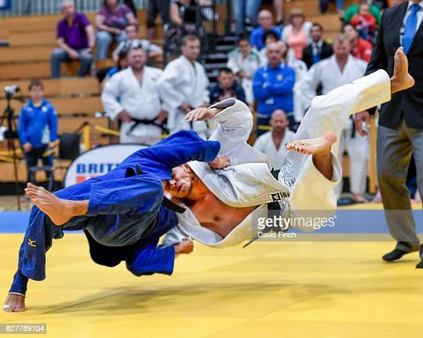 Ramil Gasimov of Azerbaijan flicks Serhii Kotenko of Ukraine onto his back for ippon to take Azerbaijan to three to nil in their final team contest...