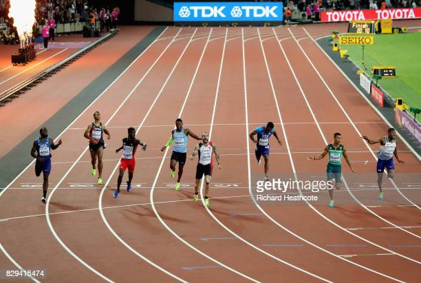 Ramil Guliyev of Turkey celebrates as he crosses the line to win also pictured are Ameer Webb of the United States Abdul Hakim Sani Brown of Japan...
