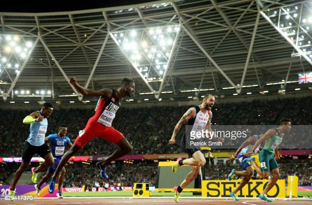 Ramil Guliyev of Turkey gold Wayde van Niekerk of South Africa silver and Jereem Richards of Trinidad and Tobago bronze cross the line in mens 200...