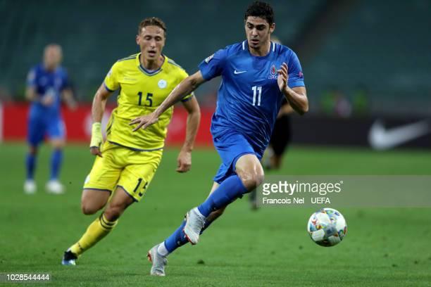 Ramil Sheydayev of Azerbaijan is challenged by Mergim Vojvoda during the UEFA Nations League D group four match between Azerbaijan and Kosovo at Baku...