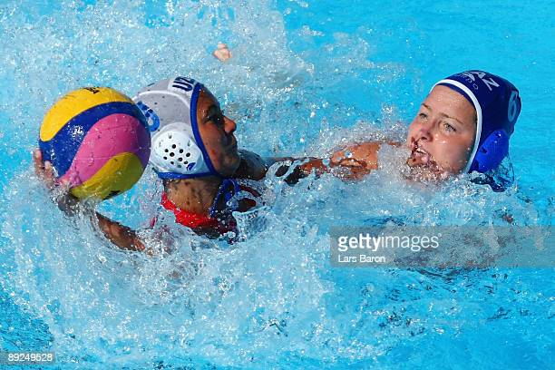 Ramilyn Halikova of Uzbekistan is challenged by Anna Zubkova of Kazakhstan in the Women's Water Polo Semifinals between Uzbekistan and Kazakhstan...