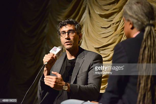 Ramin Bahrani and Elvis Mitchell attend the Film Independent at LACMA screening and QA of 99 Homes at Bing Theatre At LACMA on September 24 2015 in...