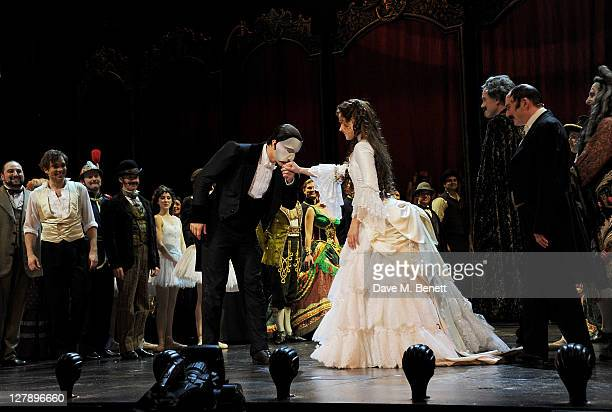 Ramin Karimloo and Sierra Boggess bow on stage during the 25th Anniversary performance of Andrew Lloyd Webber's 'The Phantom Of The Opera' presented...