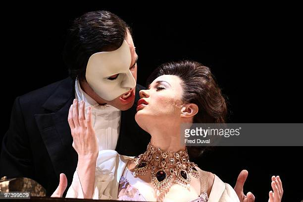 Ramin Karimloo and Sierra Boggess perform onstage during the photocall for 'Love Never Dies' at The Adelphi Theatre on March 3 2010 in London England