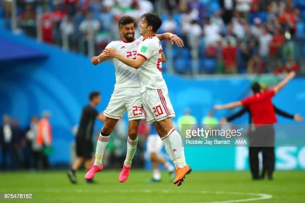 Ramin Rezaeian of IR Iran and Sardar Azmoun of IR Iran celebrate at the end of the 2018 FIFA World Cup Russia group B match between Morocco and Iran...