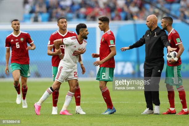 Ramin Rezaeian of Iran argues with Achraf Hakimi and Hakim Ziyach of Morocco during the 2018 FIFA World Cup Russia group B match between Morocco and...