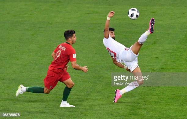 Ramin Rezaeian of Iran attempts an overhead kick during the 2018 FIFA World Cup Russia group B match between Iran and Portugal at Mordovia Arena on...