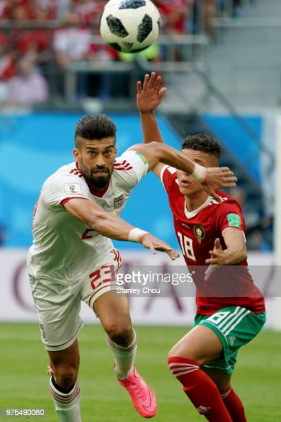 Ramin Rezaeian of Iran battles with Amine Harit of Morocco during the 2018 FIFA World Cup Russia group B match between Morocco and Iran at Saint...