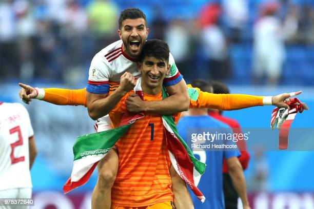 Ramin Rezaeian of Iran celebrates victory with team mate Mohammad Reza Khanzadeh at the end of the 2018 FIFA World Cup Russia group B match between...