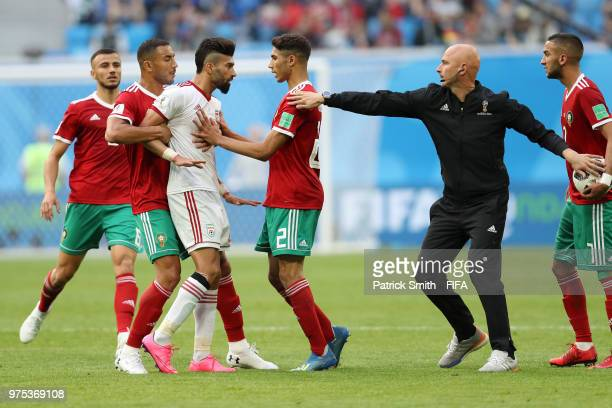 Ramin Rezaeian of Iran clashes with Achraf Hakimi of Morocco during the 2018 FIFA World Cup Russia group B match between Morocco and Iran at Saint...