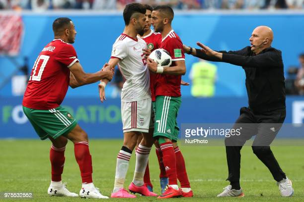 Ramin Rezaeian of the Iran national football team and Hakim Ziyach of the Morocco national football team reacts during the 2018 FIFA World Cup match...