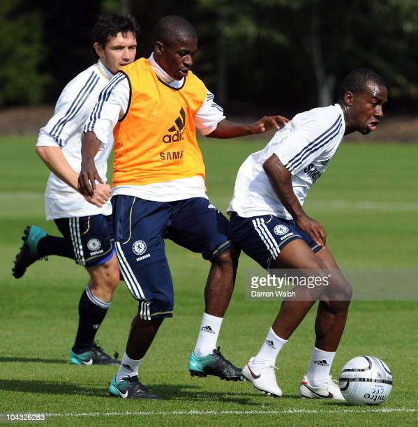 Ramires and Gael Kakuta of Chelsea during a training session ahead of their third round Carling Cup match against Newcastle United at the Cobham...