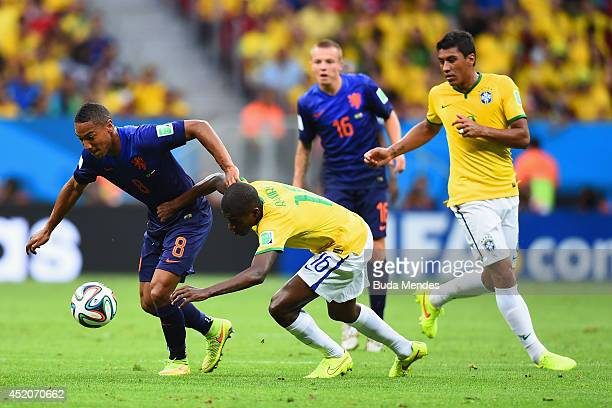 Ramires of Brazil challenges Jonathan de Guzman of the Netherlands during the 2014 FIFA World Cup Brazil Third Place Playoff match between Brazil and...
