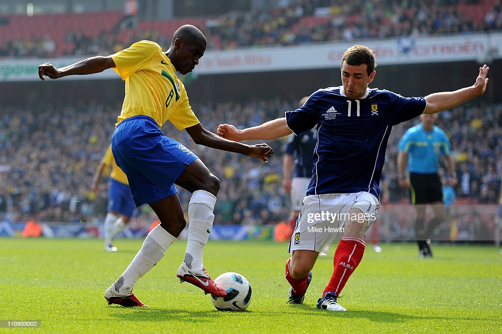Ramires of Brazil tries to get past James McArthur of Scotland during the International friendly match between Brazil and Scotland at Emirates Stadium on March 27, 2011 in London, England.