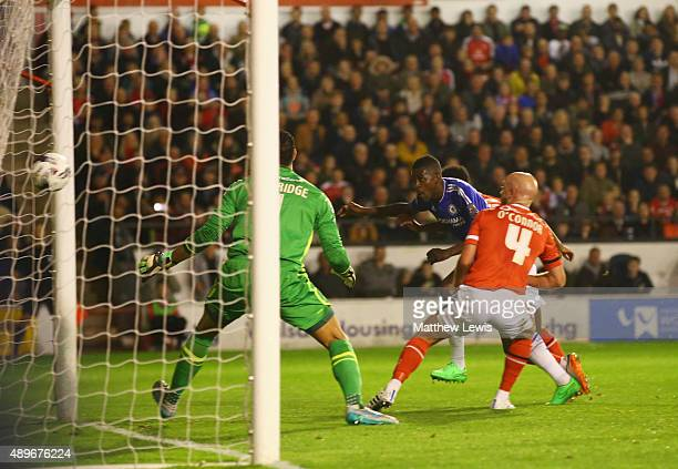 Ramires of Chelsea beats Neil Etheridge and James O'Connor of Walsall to score their first goal during the Capital One Cup third round match between...