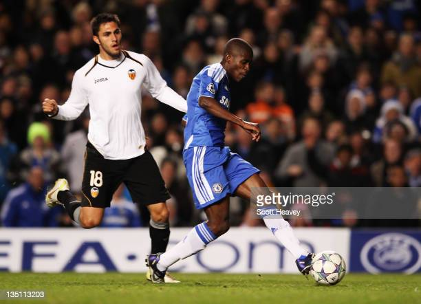 Ramires of Chelsea beats Victor Ruiz of Valencia to score their second goal during the UEFA Champions League Group E match between Chelsea FC and...
