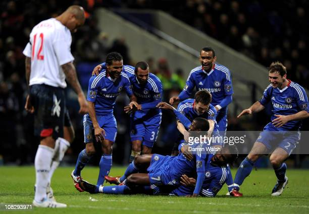 Ramires of Chelsea celebrates scoring his team's fourth goal with his team mates during the Barclays Premier League match between Bolton Wanderers...