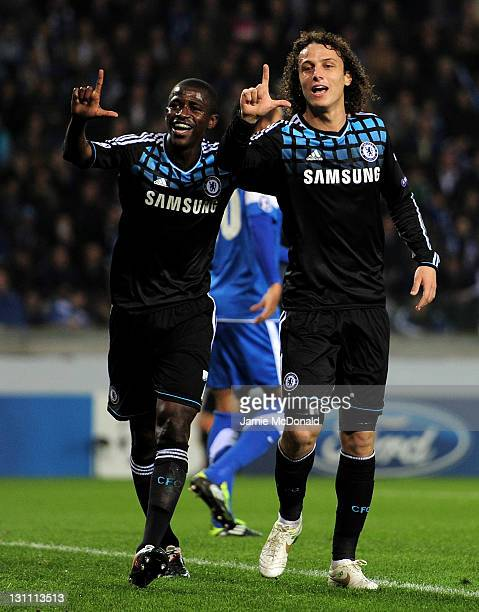 Ramires of Chelsea celebrates scoring the opening goal with team mate David Luiz during the UEFA Champions League Group E match between KRC Genk and...