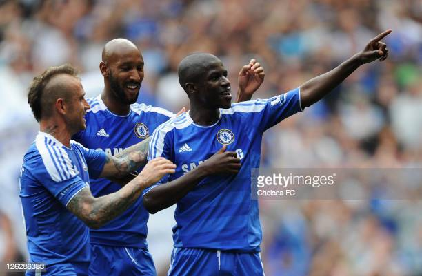 Ramires of Chelsea celebrates with Raul Meireles and Nicolas Anelka as he scores their third goal during the Barclays Premier League match between...