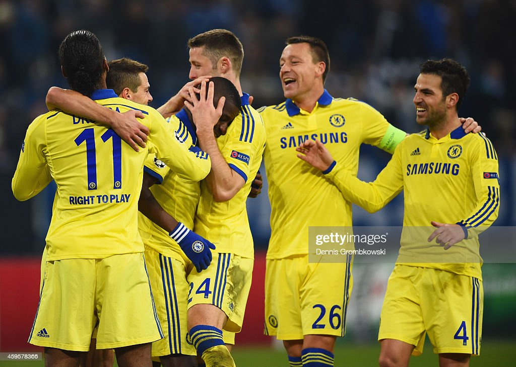 Ramires of Chelsea (3L) celebrates with team mates as he scores their fifth goal during the UEFA Champions League Group G match between FC Schalke 04 and Chelsea FC at Veltins-Arena on November 25, 2014 in Gelsenkirchen, Germany.