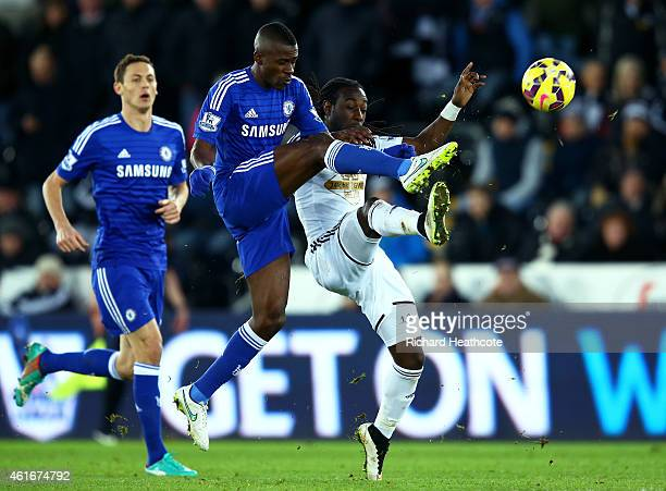 Ramires of Chelsea challenges Marvin Emnes of Swansea City for the ball during the Barclays Premier League match between Swansea City and Chelsea at...