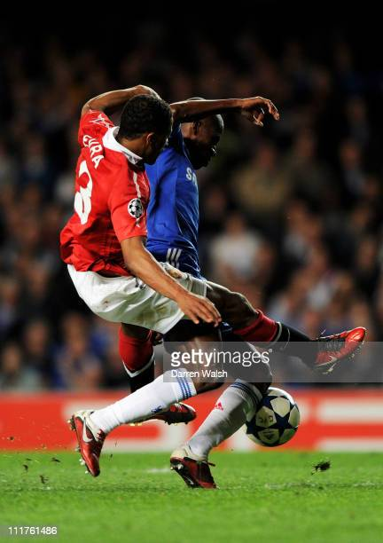 Ramires of Chelsea is brought down by Patrice Evra of Manchester United during the UEFA Champions League quarter final first leg match between...