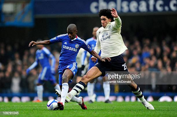Ramires of Chelsea is challenged by Marouane Fellaini of Everton during the FA Cup sponsored by EON 4th round replay match between Chelsea and...