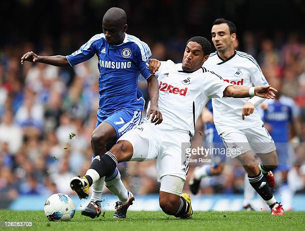 Ramires of Chelsea is tackled by Ashley Williams of Swansea City during the Barclays Premier League match between Chelsea and Swansea City at...