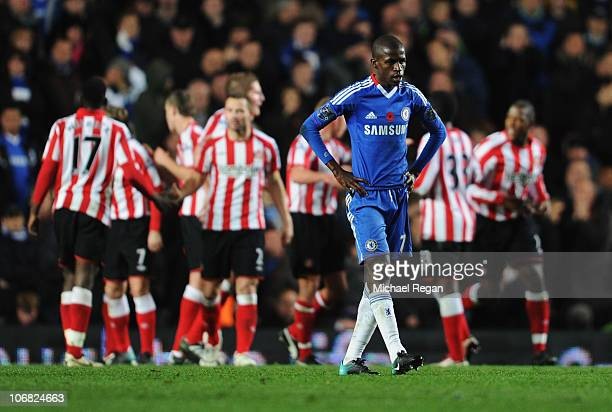 Ramires of Chelsea looks dejected as Sunderland celebrate as Nedum Onuoha scores their first goal during the Barclays Premier League match between...