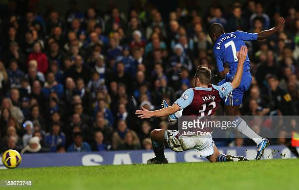 Ramires of Chelsea shoots past Nathan Baker of Aston Villa to score their fifth goal during the Barclays Premier League match between Chelsea and...