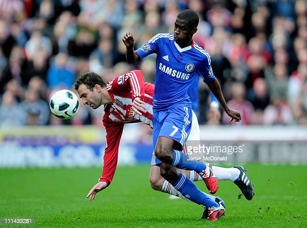 Ramires of Chelsea tangles with Danny Higginbotham of Stoke City during the Barclays Premier League match between Stoke City and Chelsea at the...