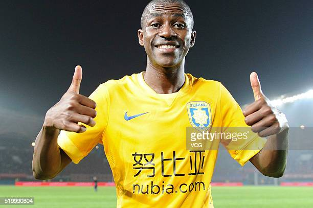 Ramires of Jiangsu Suning celebrates victory after the Chinese Football Association Super League match between Henan Jianye and Jiangsu Suning at...