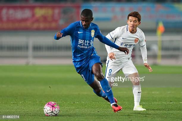 Ramires of Jiangsu Suning drives the ball during the Chinese Football Association Super League match between Jiangsu Suning and Yanbian Funde at...