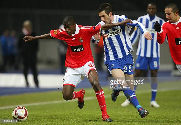 Ramires of Lisbon battles for the ball with Maximilian Nicu of Berlin during the UEFA Europa League knockout round first leg match between Hertha BSC...