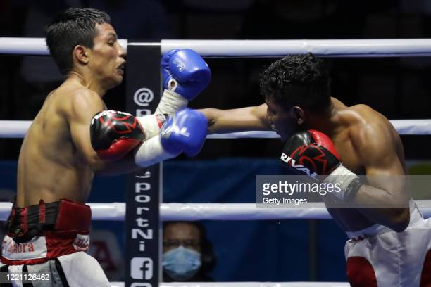 Ramiro Blanco throws a jab to Robin Zamora in the lightweight category during the main fight of the night at Alexis Arguello Sports Center on April...