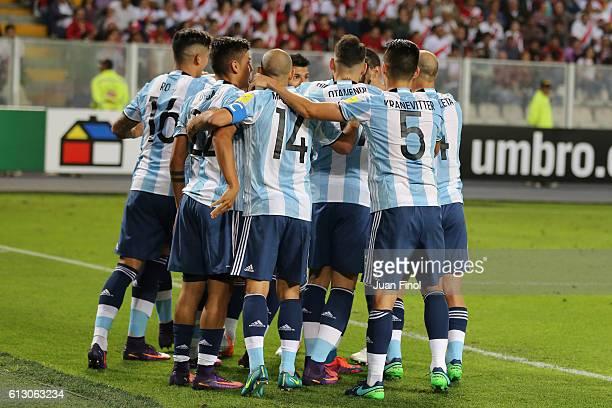 Ramiro Funes Mori of Argentina celebrates with teammates after scoring the opening goal at Nacional Stadium on October 06 2016 in Lima Peru Peru will...