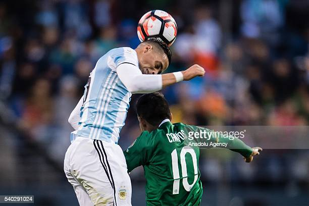 Ramiro Funes Mori of Argentina struggles for the ball against Jhasmany Campos of Bolivia during the 2016 Copa America Centenario Group D match...