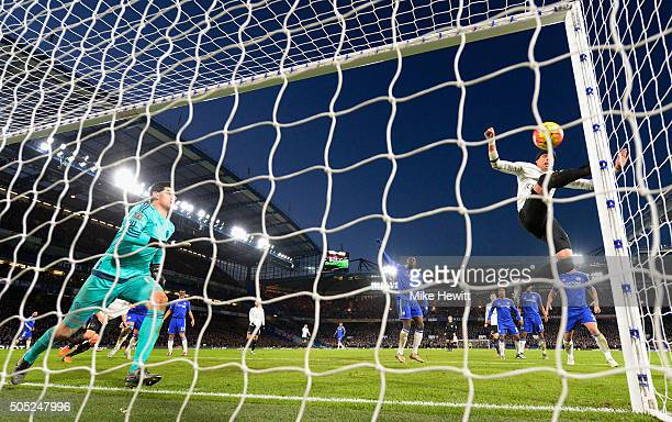 Ramiro Funes Mori of Everton scores his team's third goal past Thibaut Courtois of Chelsea during the Barclays Premier League match between Chelsea...