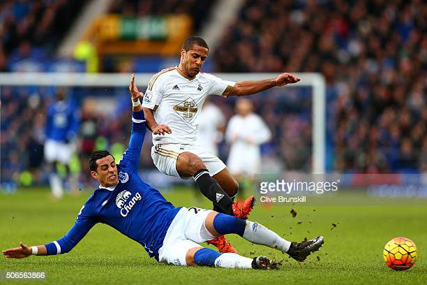 Ramiro Funes Mori of Everton slides in on Wayne Routledge of Swansea City during the Barclays Premier League match between Everton and Swansea City...