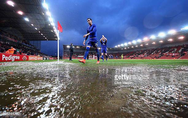 Ramiro Funes Mori of Everton walks off the waterlogged pitch after the Barclays Premier League match between Stoke City and Everton at Britannia...