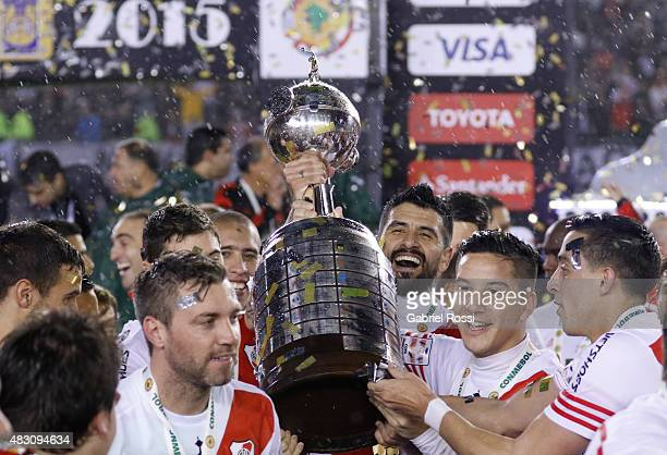 Ramiro Funes Mori of River Plate and teammates lift the trophy after winning a final match between River Plate and Tigres UANL as part of Copa...
